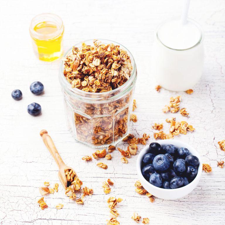 Healthy breakfast. Fresh granola, muesli with berries, honey
