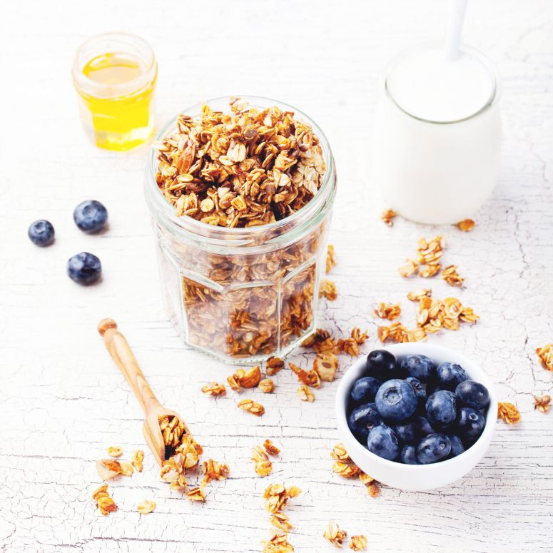 Healthy breakfast. Fresh granola, muesli with berries, honey
